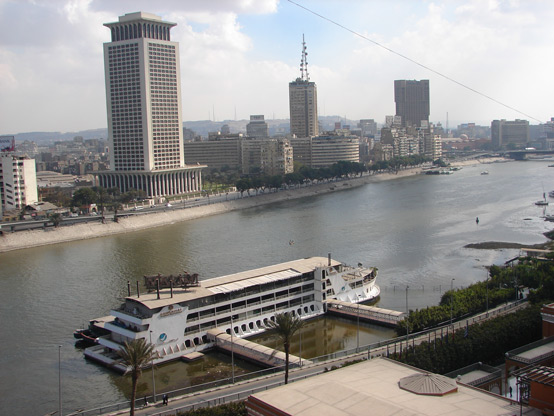 View of the Nile's east bank in CBD from the Marriott Hotel. Landmarks visible on the east bank include (from left to right) the Ministry of Foreign Affairs building, the radio and TV building, the Ramses Hilton Hotel, and the 6th of October Bridge.