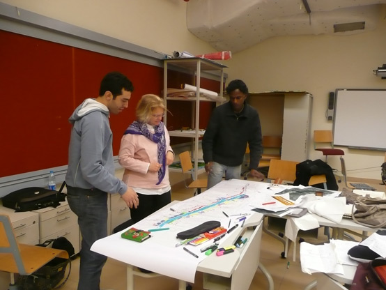 Ali, Professor Mozingo, and Krishna evaluate proposed designs for a continuous river trail along the Nile.