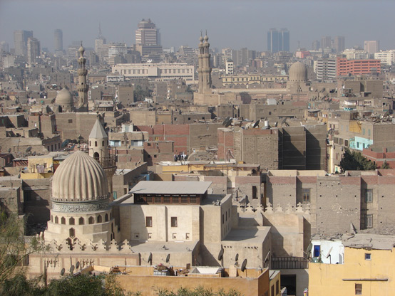 Cairo struggles with the impacts of population growth and urbanization on traffic, air pollution, and informal housing settlements.