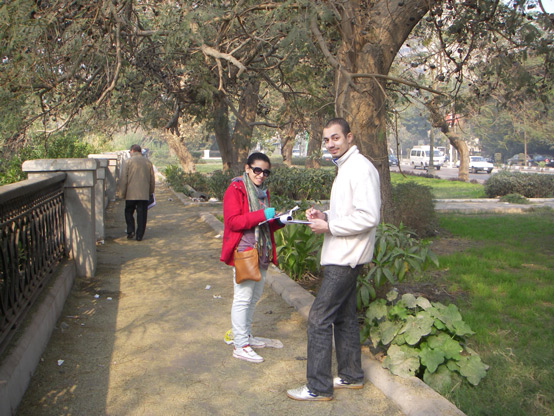 Ahmed and Malak survey bankside conditions in the suburb of Maadi.