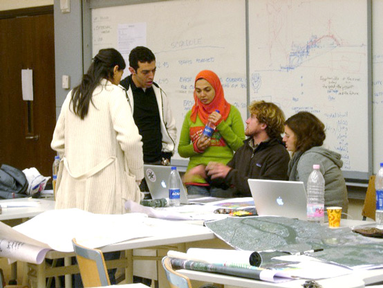One of the small collaborative student groups discusses a strategic plan for the four study reaches along the Nile.