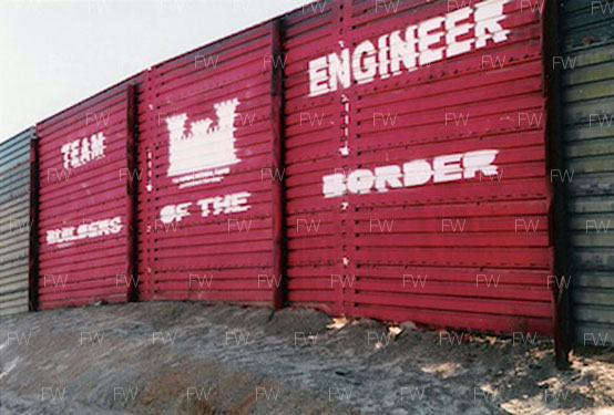 Border fencing during 1990s Operation Gatekeeper era, near Campo, California