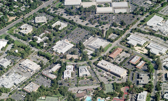 The Stanford Research Park, a speculative, for-profit office park development of Stanford University built for tenant corporations. The Hewlett Packard facility is at the top of the photograph, the canted foursquare of buildings surrounding an interior courtyard.