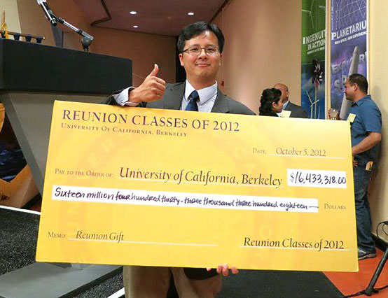 Michael Lin with reunion class donation check