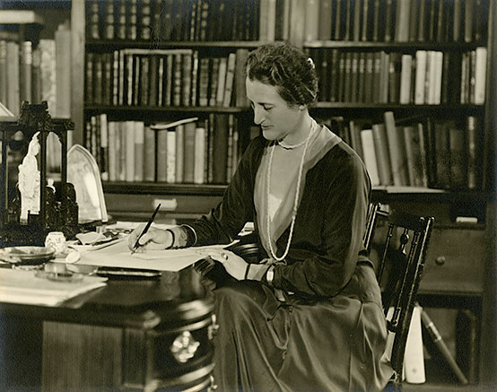 Beatrix Farrand sitting in her Reef Point Library