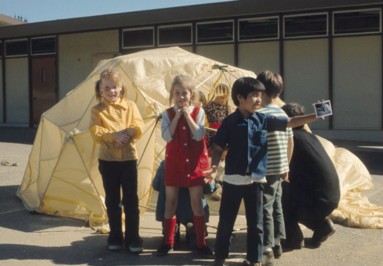School children with geodesic dome