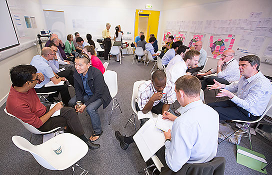 "Schmidt-MacArthur fellows and mentors holding an ideation ""lightning round."""
